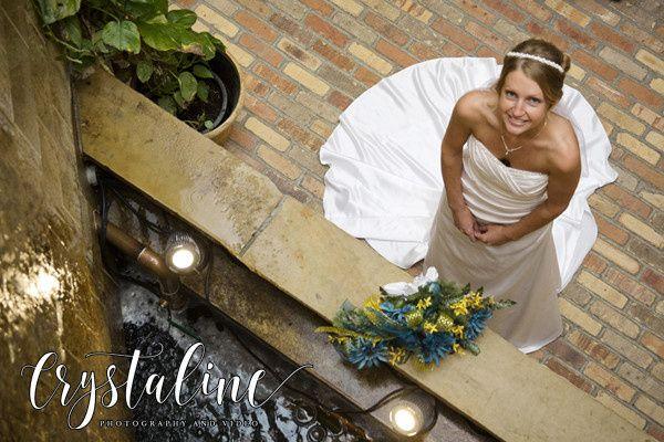 Bride poses at the fountain at Della Terra Event Chateau
