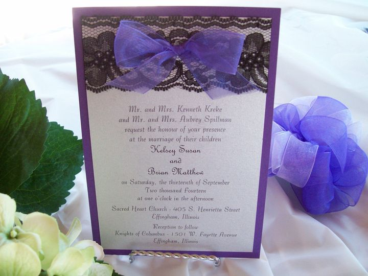 Invitation with a purple backer and white top with black lace