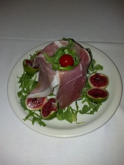 One of many options for your catering event. Prosciutto and fresh figs over arugula salad
