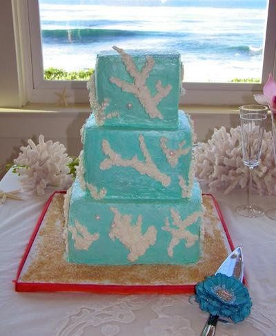 White Coral Wedding Cake on an Ocean of Blue.  Original design by Gail Watson, NYC and as seen on...