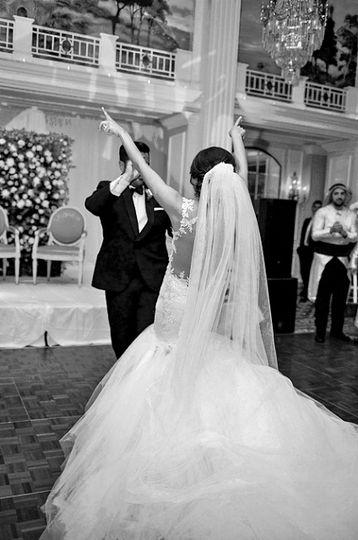 Bride &  Groom dancing.