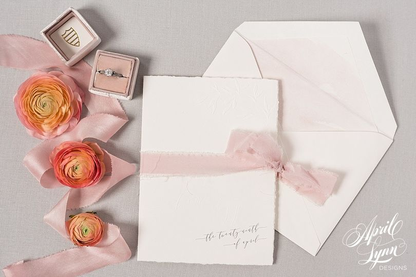 White invitation with pink ribbon