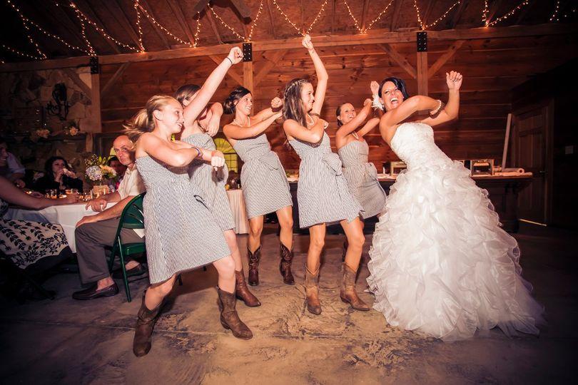 Bride with bridesmaids dancing