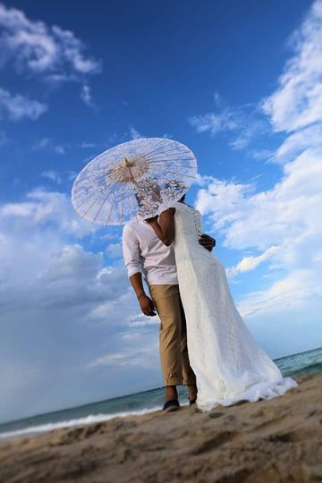 Newlyweds with their parasol