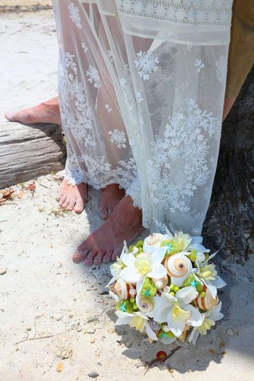 Bouquet by the bride's feet