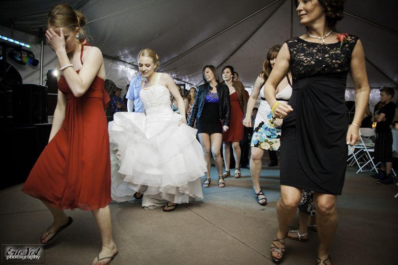 Guests and bride dancing