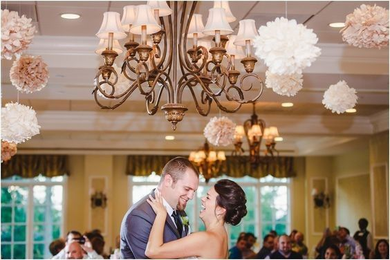 Couple dance under chandelier