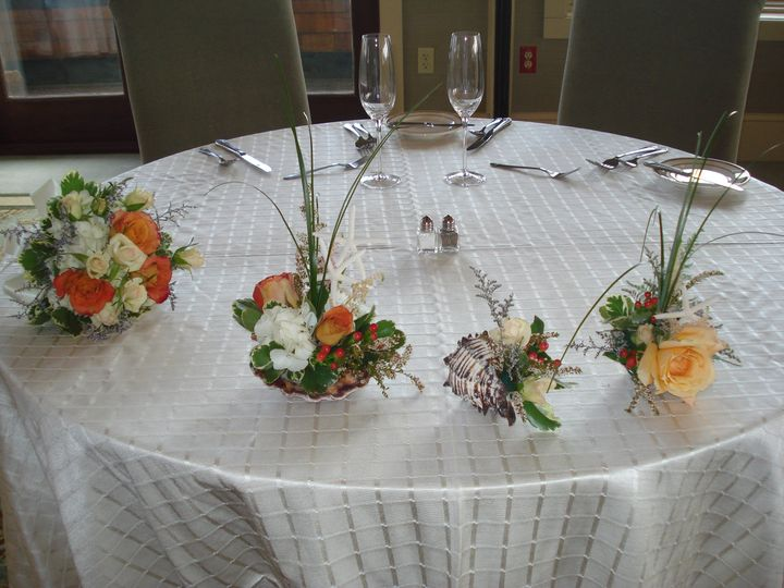 Atlantic Beach Club, Newport, RI. Sweetheart table decor. Custom arrangements made in shells