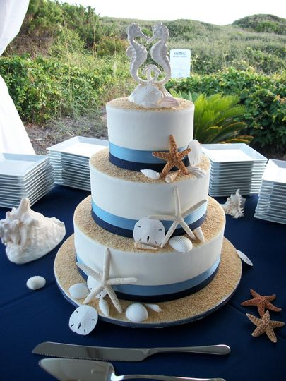Beach themed wedding cake with seahorse topper