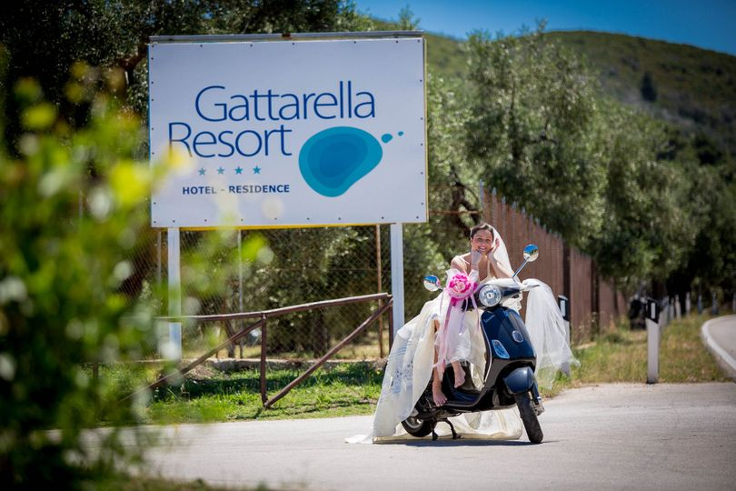 Bride on the Vespa by the signage