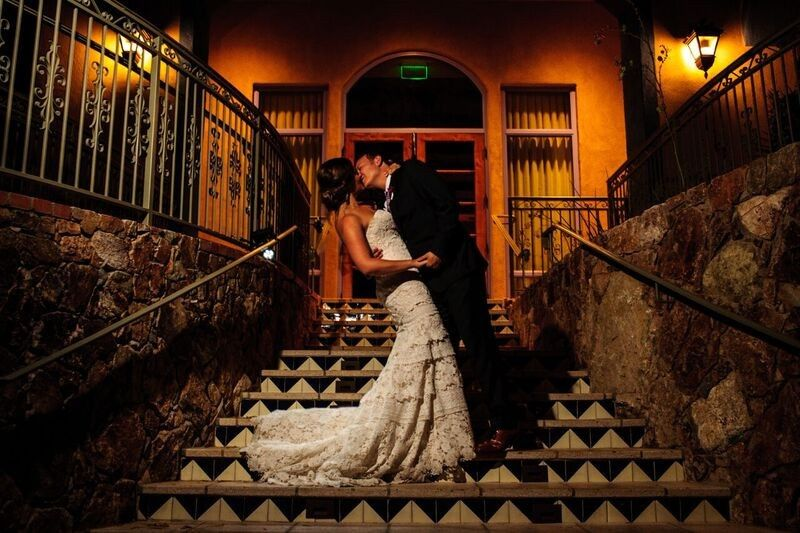 Kissing by the stairs