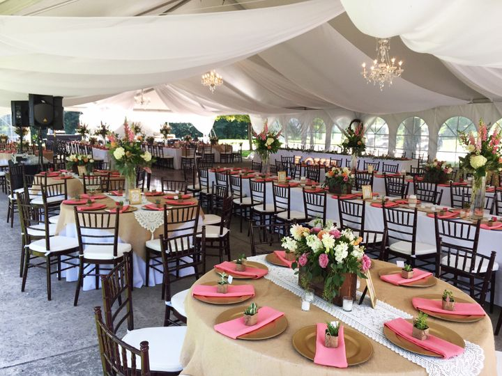 wedding reception tent with sheer drape tables and