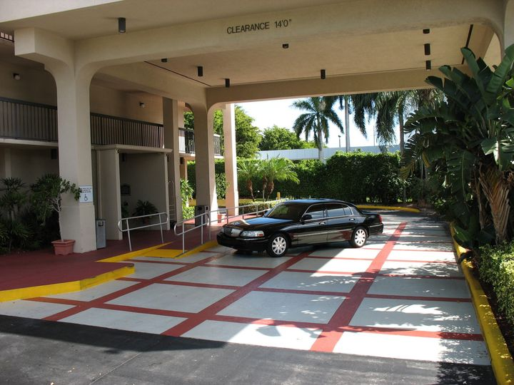 The Stay Inn's Portico with Lincoln Town Car.