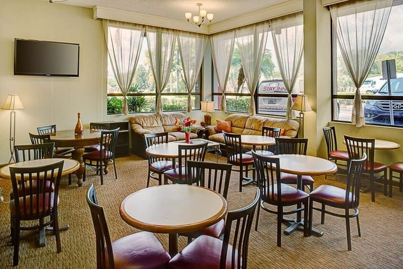 The Stay Inn's comfortable Lobby equipped with High Speed Wireless Internet Service and where...
