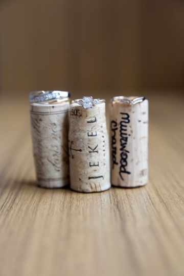 Wedding rings sitting on wine bottle corks