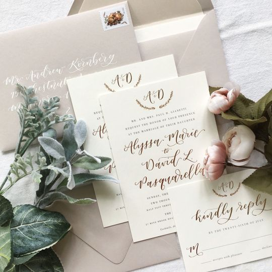 Beige envelopes and gold text