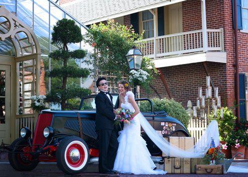 Couple beside bridal car
