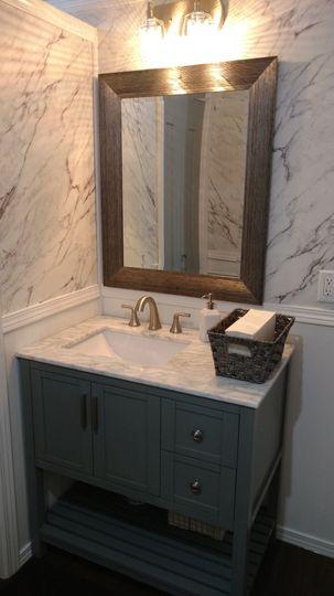 Deluxe Suite Men's marble topped vanity in luxury restroom trailer
