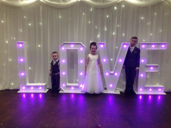 Giant love letters in purple at Blancos hotel, port talbot