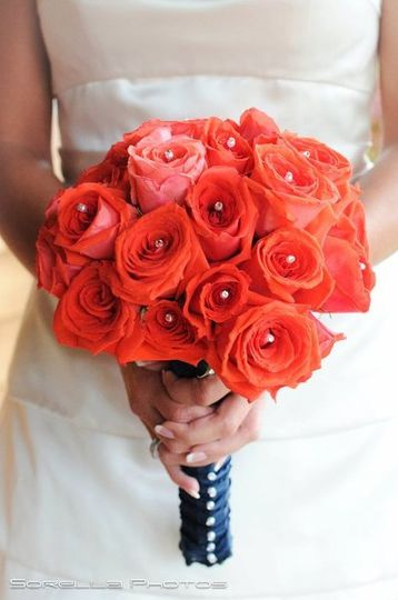 Brides bouquet by Sweet Bliss Events. Salmon colored roses with rhinestones.