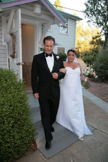 Lindsay walking down the aisle with her father at The Beda Place.