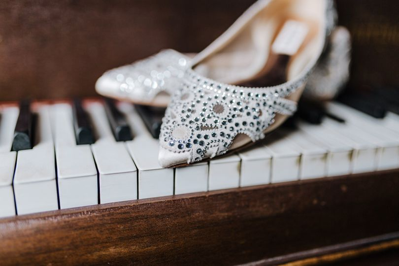 Beautiful wedding shoes on the piano