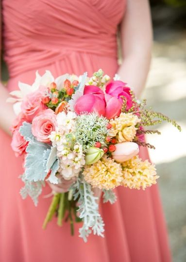 The bridesmaids holding her bouquet