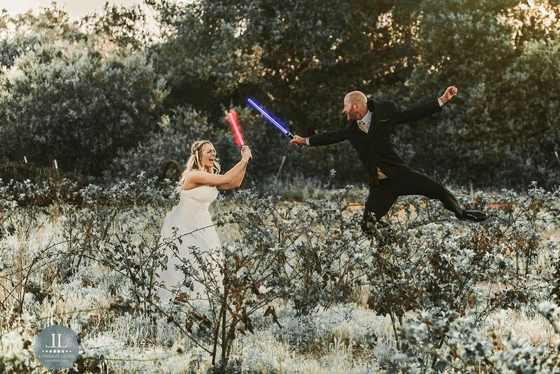 Newlyweds with their lightsabers