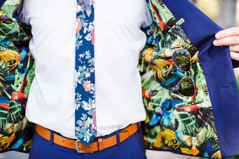 Floral details on suit jacket and tie