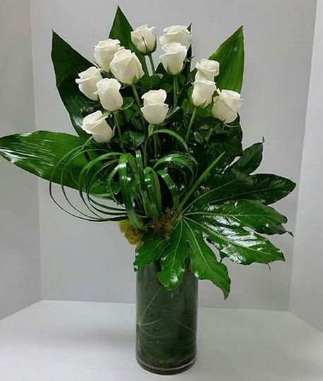 Small roses in flower arrangement