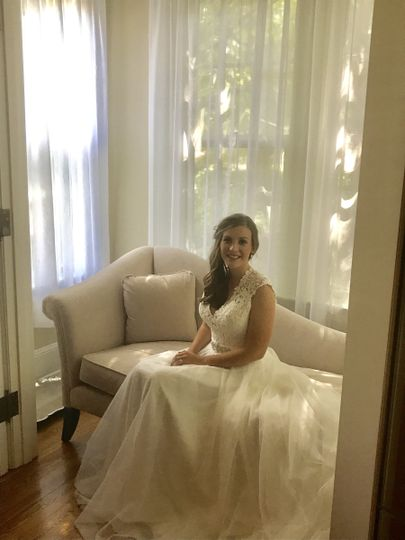 Beautiful bride on the chaise in the dining nook.
