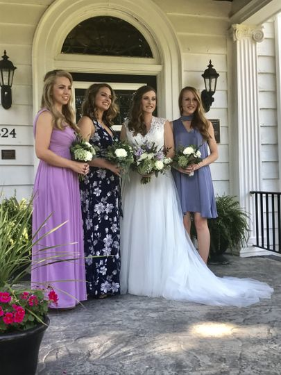 Bridal party on the front porch of the house.