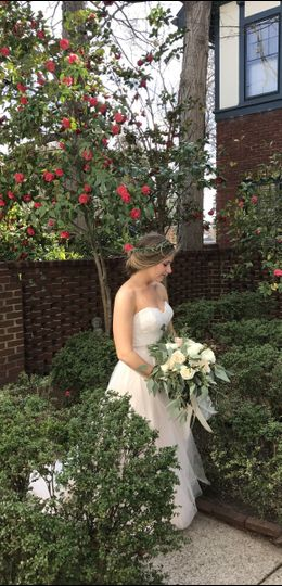 Camellias on the patio enhance this February bride.
