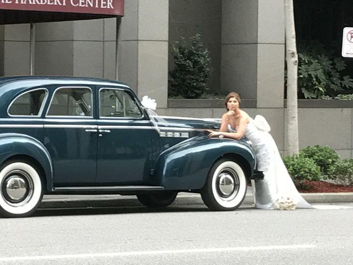 Bride and vintage car
