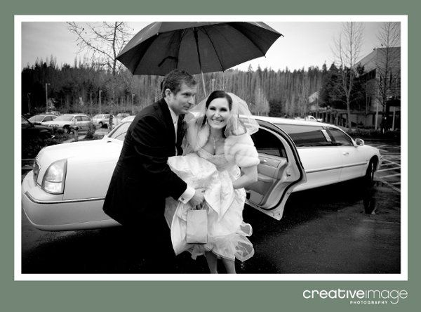 Bride and groom exiting white stretch limousine