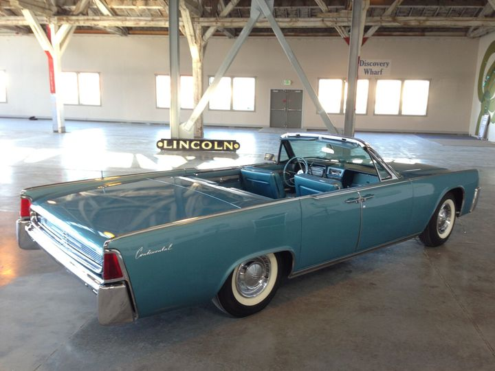 1961 Lincoln Continental Convertible with top down