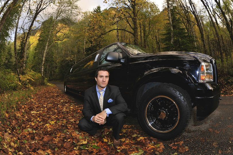 13-passenger Super Stretch Excursion limousine in fall leaves