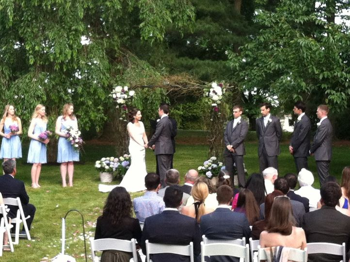 Ceremony in Bride's family home backyard