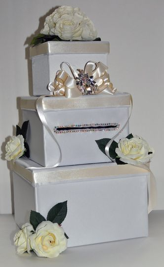 This beautiful 3-tier square wedding money box comes adorned with white satin fabric and white roses...