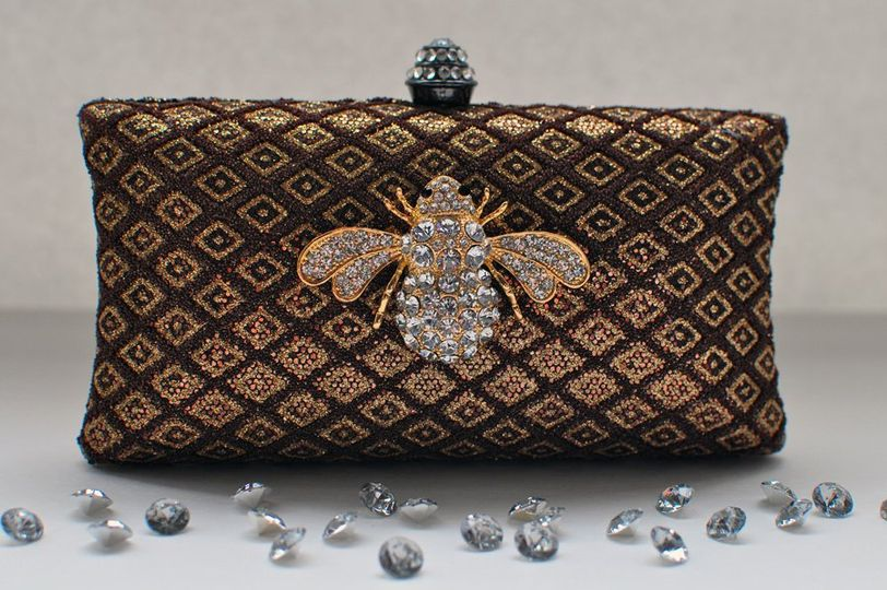 This brown and gold clutch is perfect for your special day. Whether it matches your colors or your...