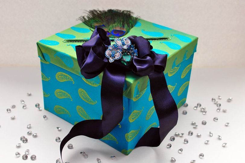 "This gorgeous money box can hold upto 30 cards. The box has a slit 1/2"" in wide and 8"" long.  The..."