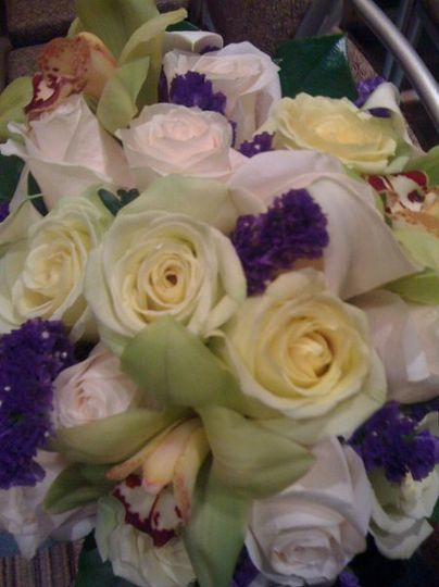 White bouquet with purple accents
