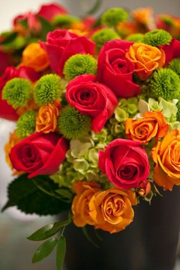 Orange and red themed floral arrangement