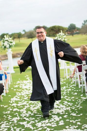 Minister walking down the aisle