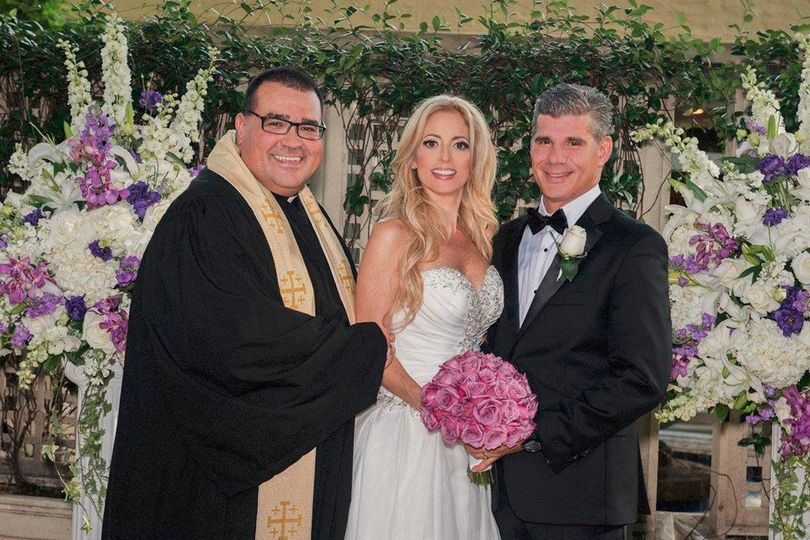 Reverend with the bride and groom