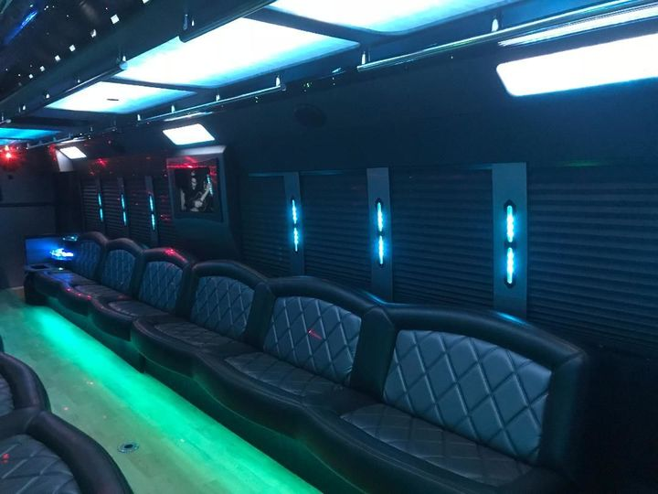 Ford F750 limo bus. Black, seats up to 50 passengers. Ideal for 40 adults. Equipped with wrap around...