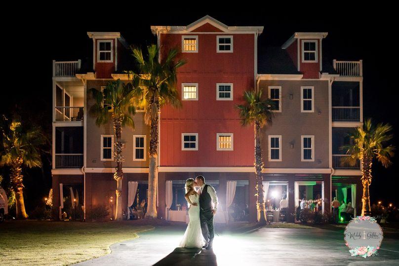 Couple posing in front of Regatta Inn