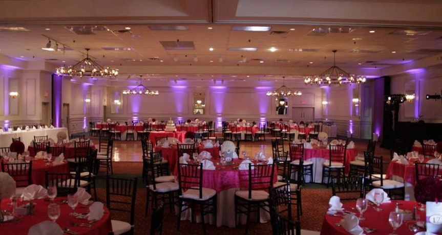 All four banquet rooms were used for this reception. The up lighting, chairs, and red linens were...