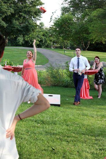 Bridal party playing backyard games