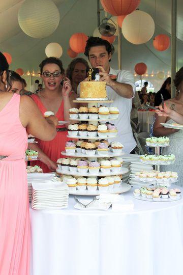 Guests enjoying the wedding cake